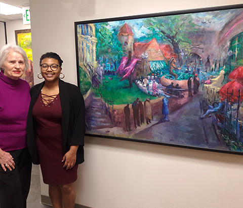 "St. Peter's Anglican Church in Mt. Brook, Alabama. Pictured: Miriam McClung, artist (left), Kat Ladd, curator (right). ""Good Friday at Five Points"" by Miriam McClung, oil on linen."
