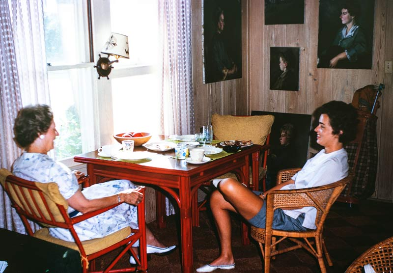 Miriam's mother (left) visiting Miriam (right) in Sarasota, Florida. Note the paintings on the wall of the cottage done at the school.
